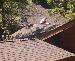 Man Installing a Roof on a House, Galt, CA
